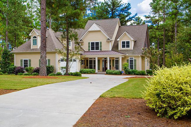 custom home with mature landscaping